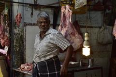 肉を売る男