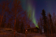 A cottage with northern lights