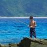 PENTAX PENTAX K-7で撮影した人物(海で釣り)の写真(画像)