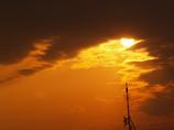 呼子の垣間見えた夕日です。
