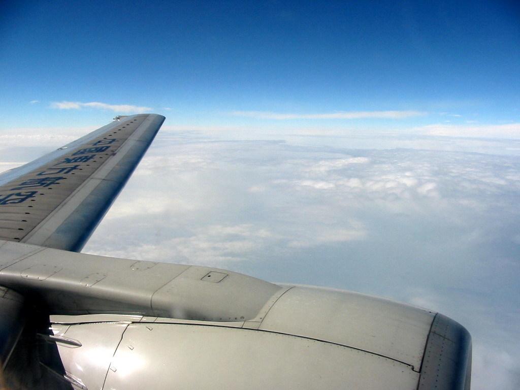 飛行機乗って、韓国に行く