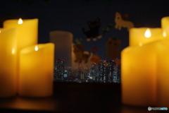 ろうそくの灯りと夜景