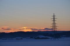 夕焼けに鉄塔