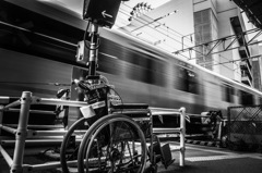 Wheelchair, running train & ferris wheel