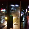 Telephone booth in rain