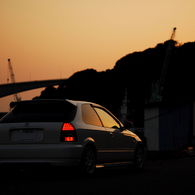NIKON NIKON D200で撮影した乗り物(夕焼けとタイプR)の写真(画像)
