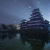 春雪吹雪く松本城