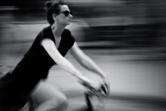 a beautiful women rinding a bike