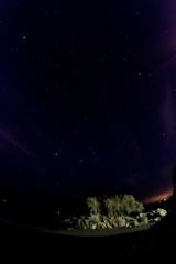 日出の石門と星座たち