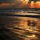 雪雲から覗く夕日千里浜海岸