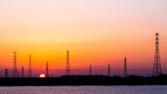 Sunrise and steel tower