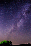 A shooting star along the Milky Way