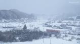 雪に煙る鉄橋で