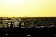 夫婦と夕日