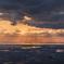 光射す日本海と庄内平野
