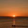 日の出と漁船