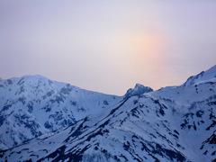 赤光柱上がる山稜