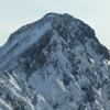 頂きに挑む登山者
