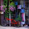 赤い自転車と花と・・・
