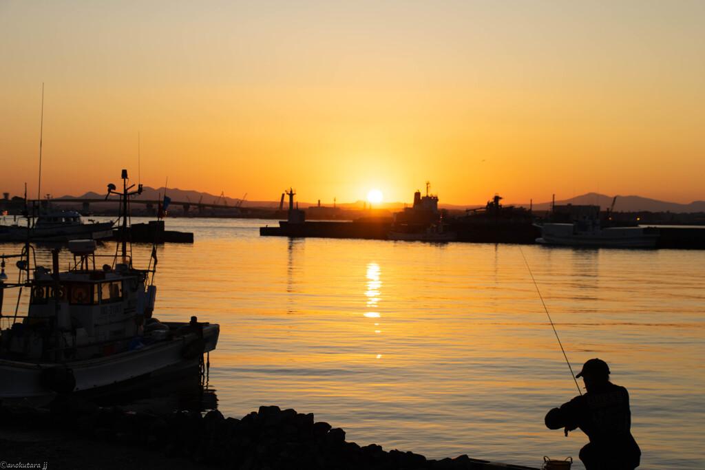 夕日とともに