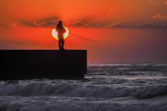 釣れない海に太陽が。