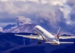 阿蘇の噴煙と飛行機