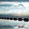 浦安護岸の朝景 陽の光映す水たまり