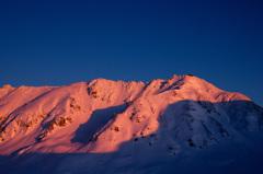 夕日に染まる立山