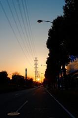 夕日と道路と鉄塔