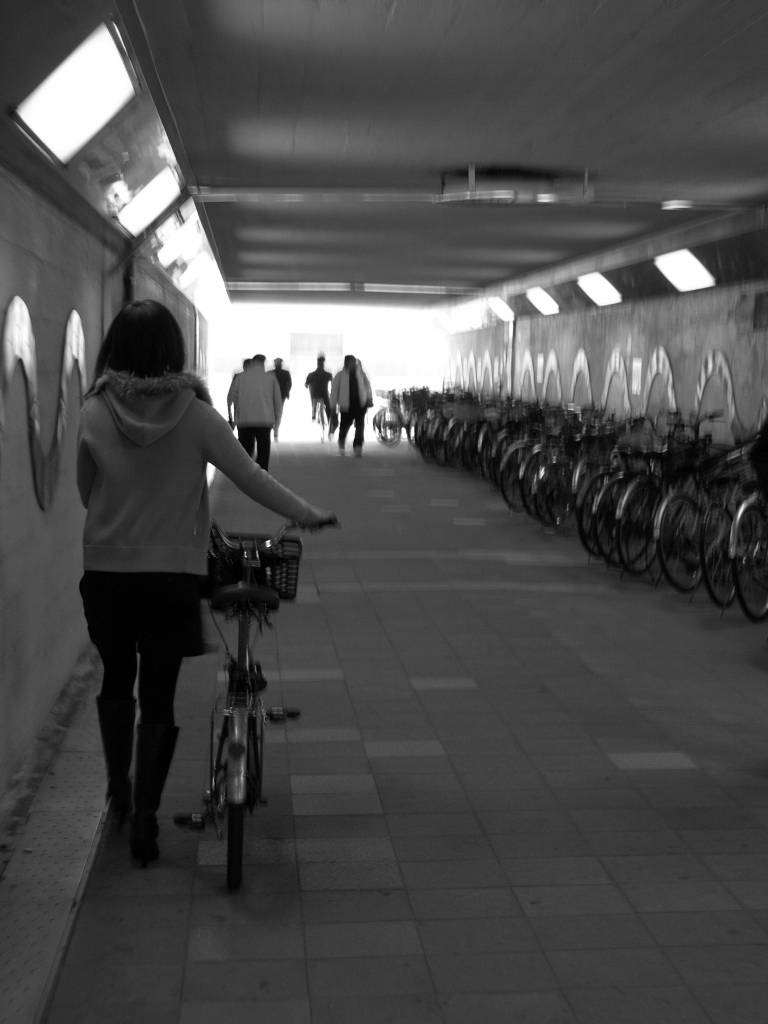 walk with her bicycle