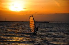 夕陽と波乗り