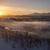 川霧に朝陽