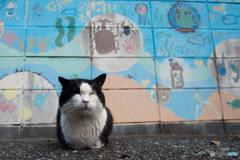 ボス。壁画の前で。