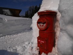 Mail post in deep snow
