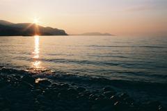 フイルムで夕日と海