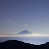 Star falls gently to sleeping Fuji