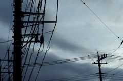 Telegraph poles with cloudy sky