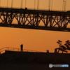 夕陽を追うカメラマン