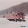 雪の降る駅