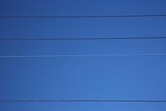 電線と電話線と青空
