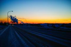夕焼けと砂糖工場の水蒸気