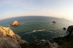 日出の石門と神島