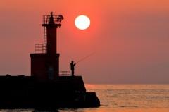 朝の釣り人