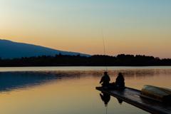 朝焼けと釣り人