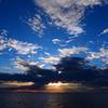 黒い雲、白い雲、青い空、と、夕陽
