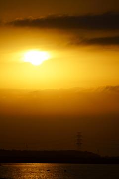 夕陽に焼かれ